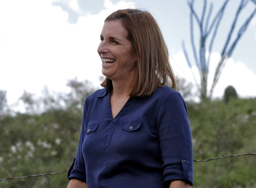 Rep. Martha McSally (R-Ariz.), who is running for the U.S. Senate, laughs while touring near the border with Mexico, south of Arivaca, Ariz.