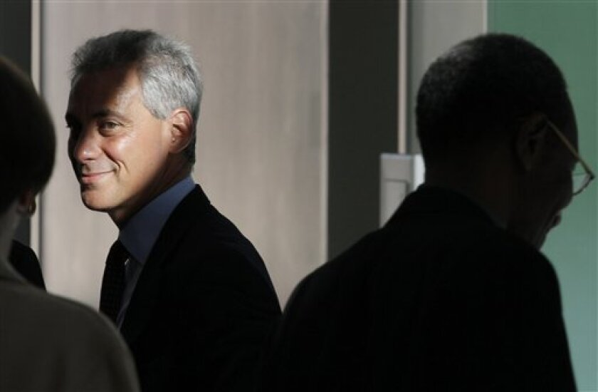 Chicago mayoral candidate Rahm Emanuel waits in the wings before speaking at a news conference at the Better Boys Foundation, Tuesday, Jan. 4, 2011, in Chicago. (AP Photo/M. Spencer Green)