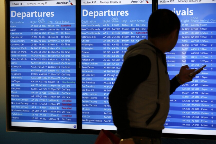 American Airlines flights out of Los Angeles International Airport are cancelled due to a storm on the East Coast in January, 2015. A university study says that the drawbacks of regular travel, such as anxiety, stress and illness, are often ignored.