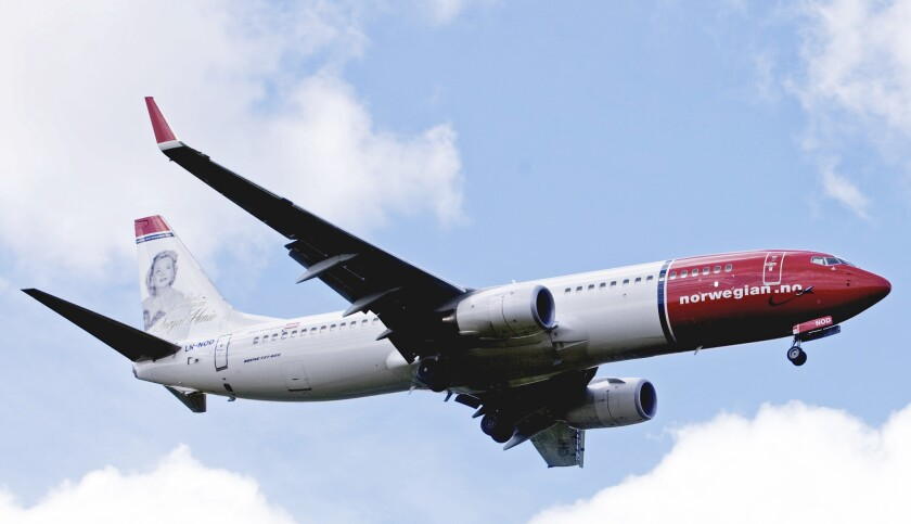 Boeing 737-800 of low-cost airline Norwegian flying near Oslo airport in Gardermoen.