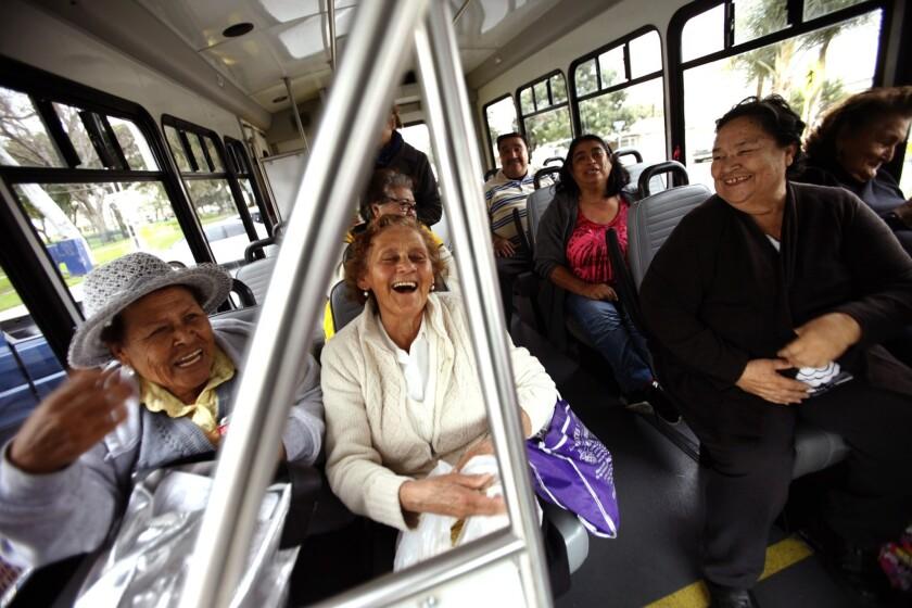 Anizeta Lopez, 77, front row left, Eloisa Ruiz, 75, Josefina Gonzalez, 73, and Clarita Trujillo, 79, enjoy one another's company while riding on the Dial-A-Ride shuttle bus in Bell Gardens.