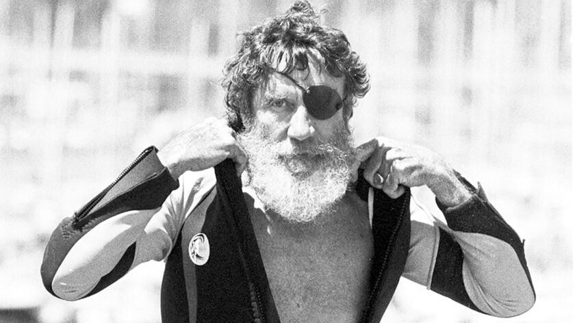 In this August 5, 1982 photo, Jack O'Neill suits up in the small craft harbor before windsurfing off