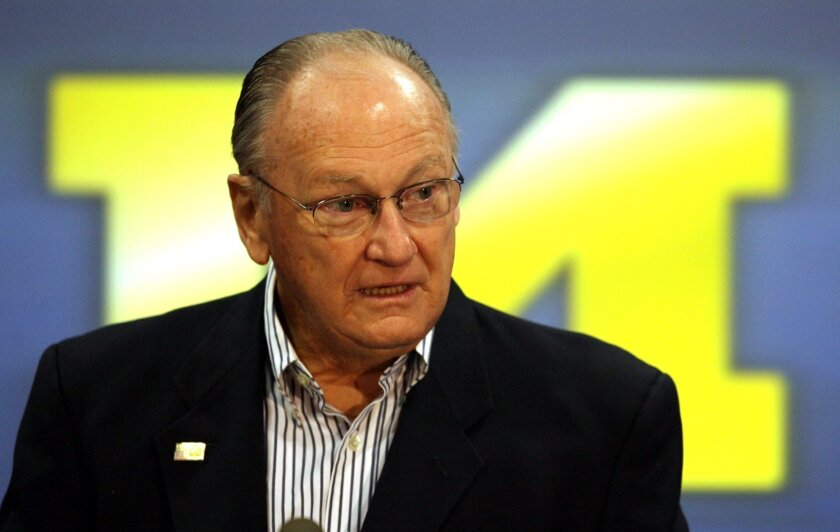FILE - in this Nov. 13, 2006, file photo, former Michigan head football coach Bo Schembechler talks to the media in Ann Arbor, Mich. A report released Tuesday, May 11, 2021, about the stunning lack of action at the University of Michigan while a rogue doctor, Robert Anderson, was sexually assaulting hundreds of young men has pointed an unflattering light at one of the school's giants, the late football coach Bo Schembechler, whose bronze statue stands on campus. (Mandi Wright/Detroit Free Press via AP, File)