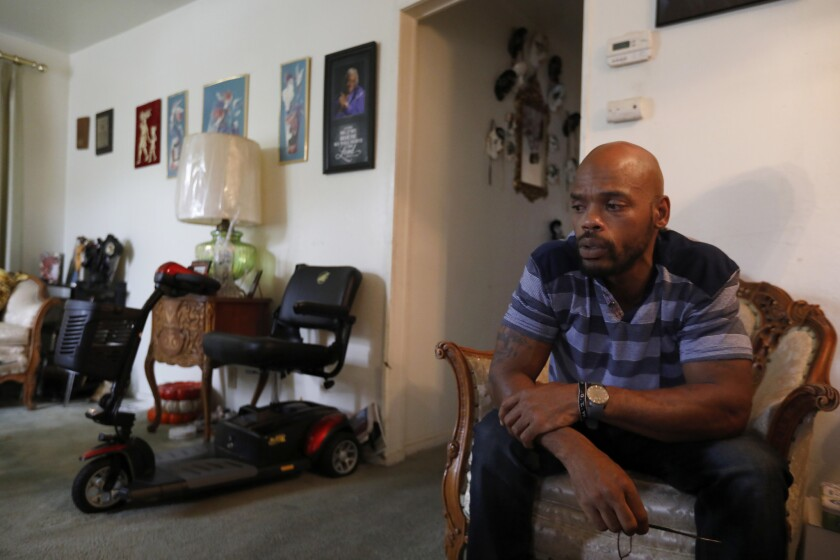 Zavion Johnson sits in his great-grandmother's Sacramento home. Johnson was exonerated in 2017 in the death of his daughter Nadia after spending 16 years in prison.