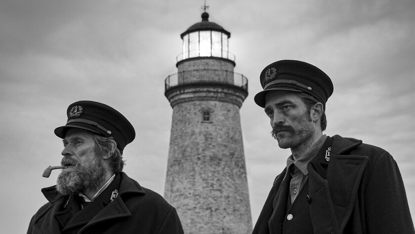 """Willem Dafoe, left, and Robert Pattinson in a scene from """"The Lighthouse."""""""