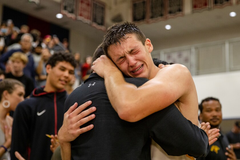 Torrey Pines High's Nick Herrmann (1) becomes emotional after his game-winning shot on Saturday night.