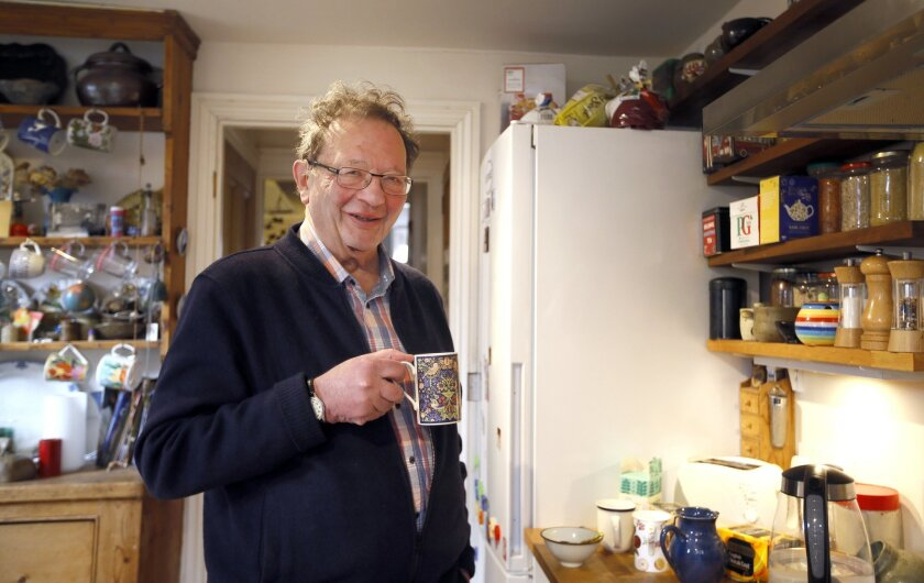 Larry Sanders at home in his kitchen in Oxford, England, Monday, Feb. 15, 2016. These are exciting times for Larry Sanders, a stalwart Green Party campaigner in Oxford, England. He's just been appointed to a new job as his party's national spokesman on health.  And he's helping out his little broth
