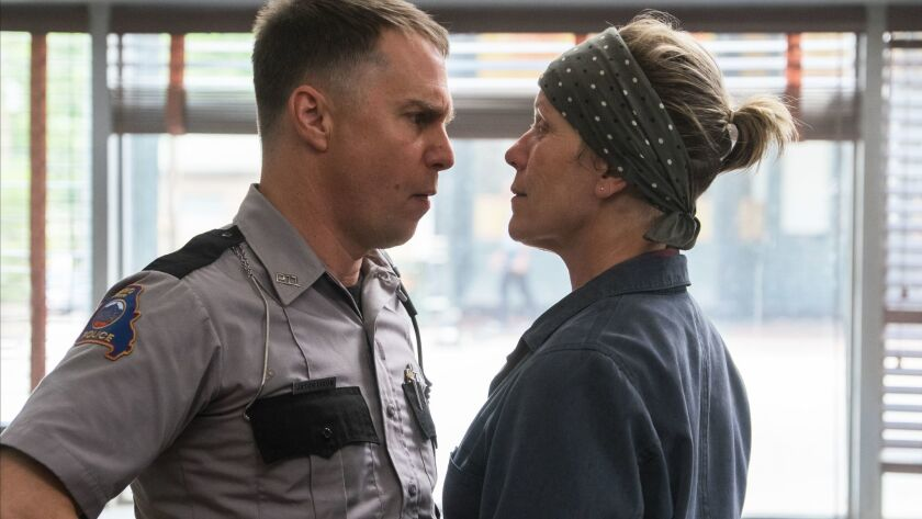 This image released by Fox Searchlight shows Sam Rockwell, left, and Frances McDormand in a scene fr