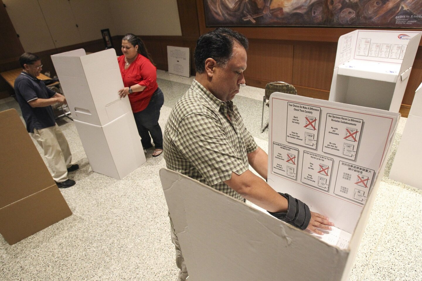 Poll workers get ready for Tuesday's vote