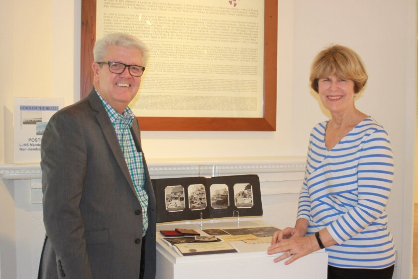 La Jolla Historical Society executive director Heath Fox and exhibit curator Seonaid McArthur review the show's components.