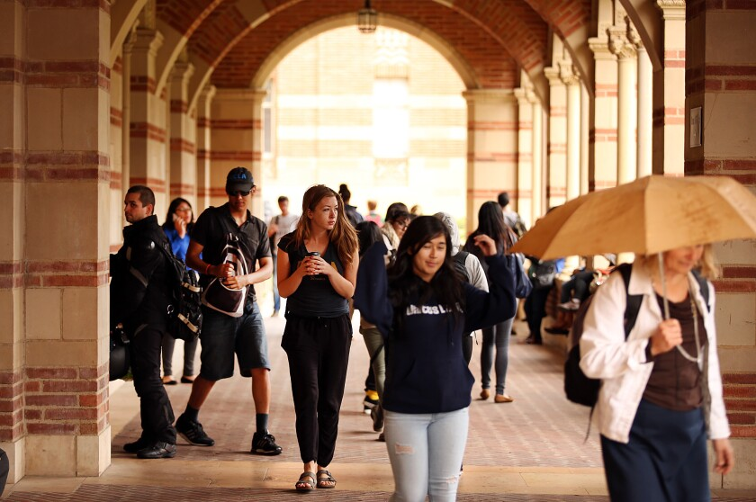 Students at Royce Hall on the UCLA campus. UC is laying the groundwork for a possible tuition increase.