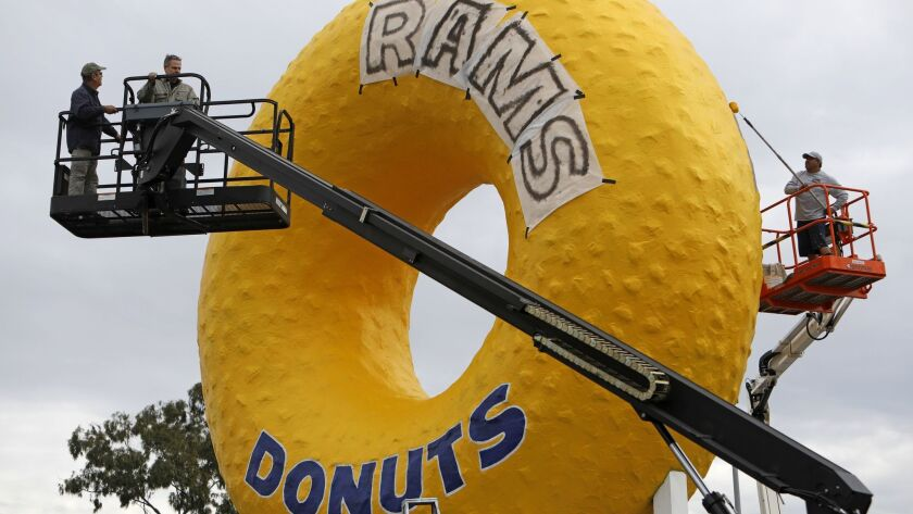 Randy's Donuts iconic sign gets a Rams-themed makeover in Inglewood, Calif. The sign, which is visible to all air passengers as they land and as they leave LAX via the 405 Freeway.