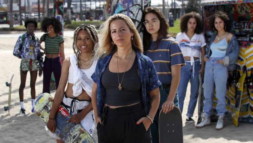 The NYC skateboarding collective known as the Skate Kitchen, from left in back, Kabrina Adams, Ajani Russell, Dede Lovelace, Rachelle Vinberg, Jules Lorenzo, and Brenn Lorenzo, star in their own film, directed by Crystal Moselle, center.
