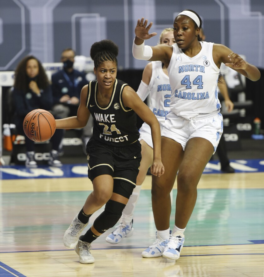 Wake Forest's Jewel Spear drives the baseline past North Carolina's Janelle Bailey during an NCAA college basketball game in the Atlantic Coast Conference tournament, Thursday, March 4, 2021, at the Greensboro Coliseum in Greensboro, N.C. (Walt Unks/The Winston-Salem Journal via AP)