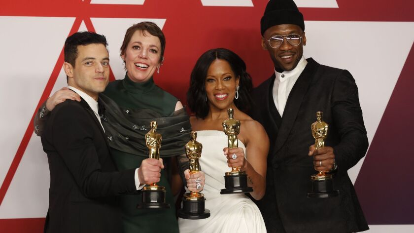 Oscar winners Rami Malek, left, Olivia Coleman, Regina King and Mahershala Ali pose with their Academy Awards at the 2019 ceremony.