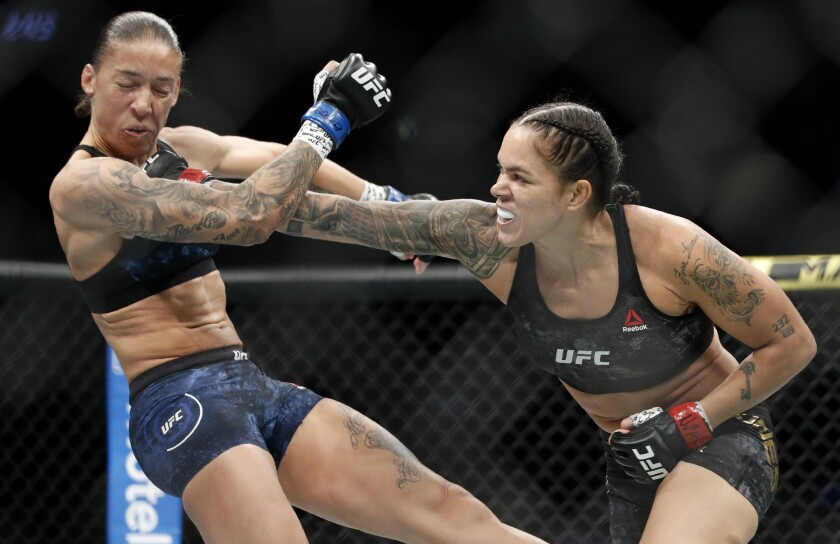 Amanda Nunes, right, hits Germaine de Randamie in their women's bantamweight title bout at UFC 245 on Saturday.