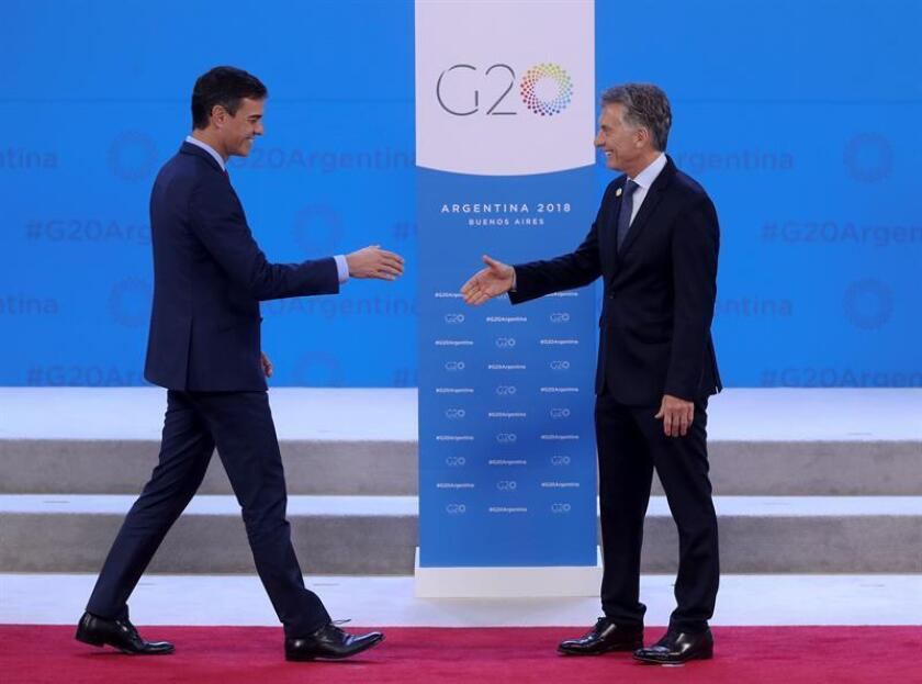 Argentine President Mauricio Macri (R) welcomes Spanish Prime Minister Pedro Sanchez (L) during the G20 Summit in Buenos Aires, Argentina, Nov. 30, 2018. EPA-EFE/ANDRES BALLESTEROS