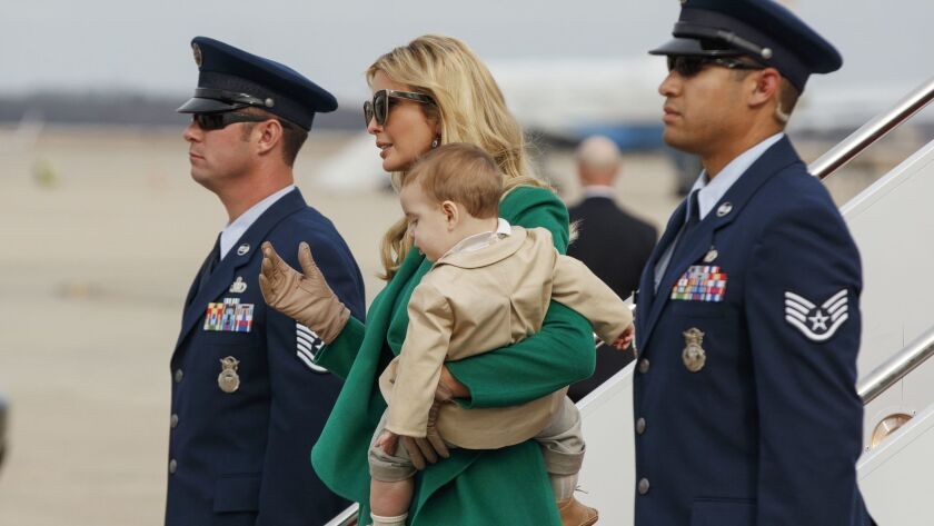 Ivanka Trump carries her son, Theodore Kushner, as they arrive at Andrews Air Force Base in Maryland.