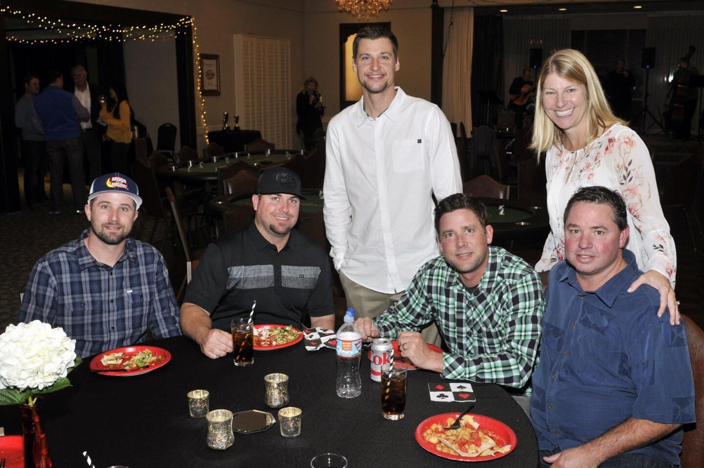 Kris Madsen, Mike Salomon, Caleb Jensen (standing), Craig Harrison, Julie and Les Blake