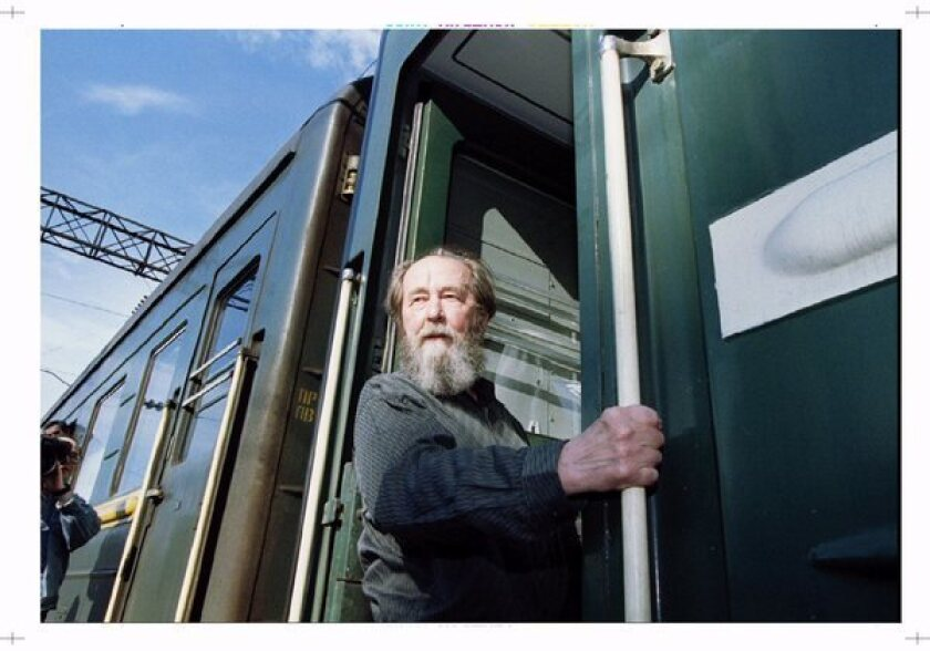 "Alexander Solzhenitsyn is shown boarding a train in Vladivostok, Russia, after 20 years of exile. His story ""One Day in the Life of Ivan Denisovich"" was the first public acknowledgment of those who suffered in the gulag during Joseph Stalin's wave of terror."