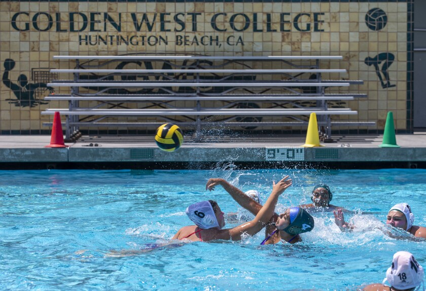 The Golden West College girls' water polo team practices Monday the first day of class.