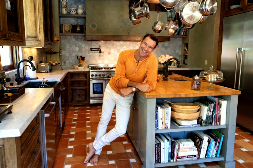Actor David James Elliott is married to entrepreneur Nanci Chambers, and she and Elliott share their 8,000-square-foot Italian villa-style home with their 16-year old son and a menagerie that includes two dogs, two rats and a lizard. Photographed June 12, 2019. (Jesse Goddard / For The Times)