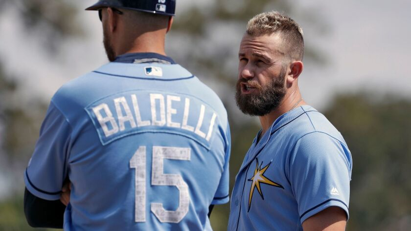 The Rays' Evan Longoria, right, talks to first base coach Rocco Baldelli during the a spring training baseball game against the Toronto Blue Jays Sunday, March 5, 2017, in Dunedin, Fla.