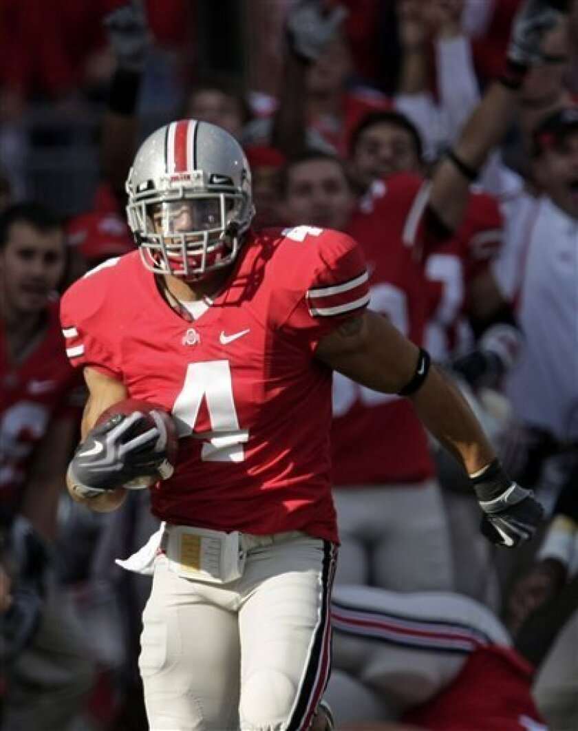 Ohio State cornerback Kurt Coleman runs for a touchdown after intercepting the ball during the first quarter of an NCAA college football game against Wisconsin Saturday, Oct. 10, 2009, in Columbus, Ohio. (AP Photo/Tony Dejak)