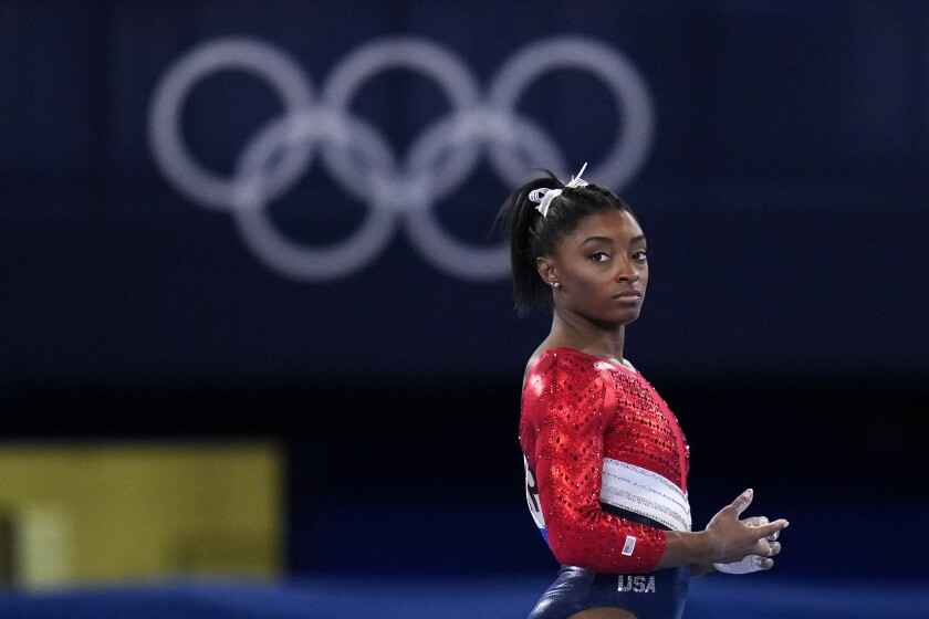 U.S. gymnast Simone Biles looks on during the women's team competition at the Olympics on Tuesday.