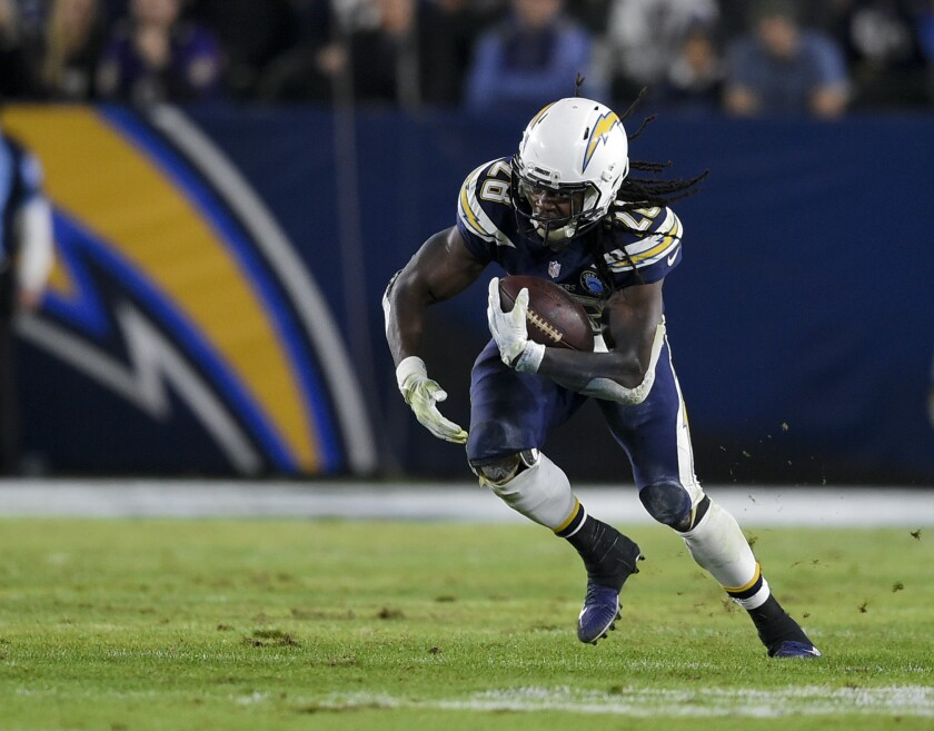 Chargers running back Melvin Gordon runs the ball during the second half against the Baltimore Ravens in Carson on Dec. 23, 2018.