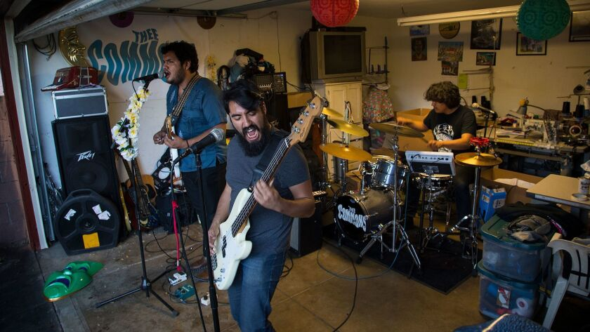 Thee Commons, a Boyle Heights-based band, during its last garage rehearsal before heading to play a