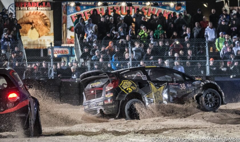 Blasting through the mud as fans look on