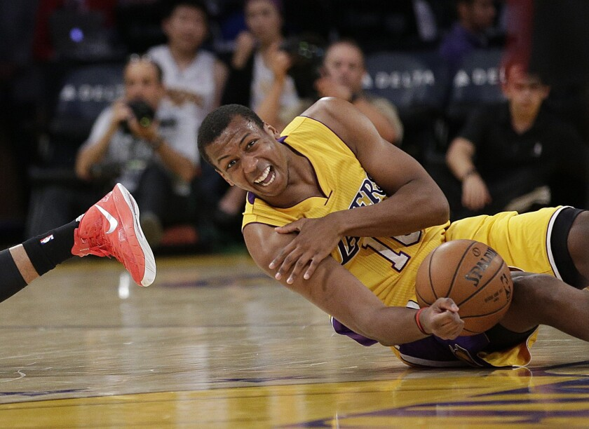 Lakers forward Jonathan Holmes grabs his shoulder after a collision with Portland's Allen Crabbe during the first half of a preseason game on Oct. 19.