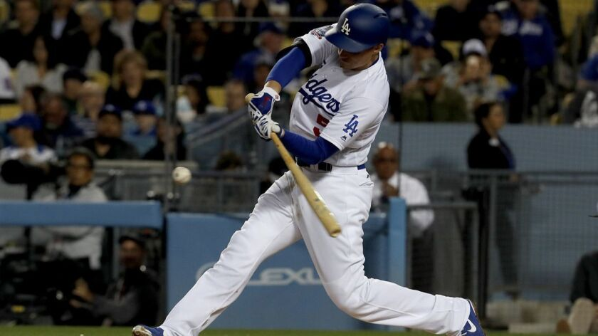 Dodgers shortstop Corey Seager connects for a double against the Marlins in the third inning Tuesday night at Dodger Stadium.