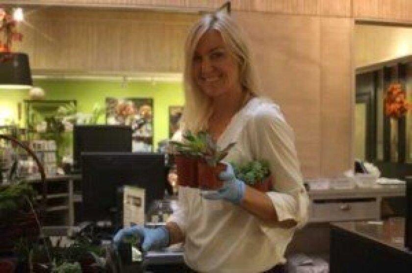 Eryn Schnitzler gathers plants for her terrarium.