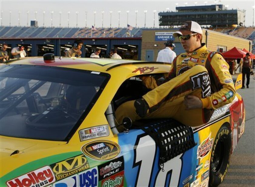 Kyle Busch climbs out of his car during qualifying for the NASCAR LifeLock.com 400 auto race at Chicagoland Speedway in Joliet, Ill., Thursday, July 9, 2009. (AP Photo/Nam Y. Huh)