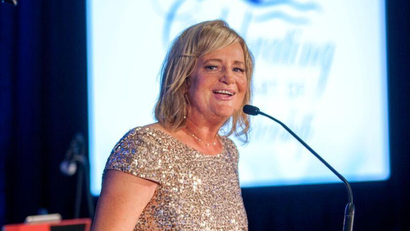 """Costa Mesa Mayor Katrina Foley formally opens the ball. Note """"Celebrating the Art of Leadership"""" pro"""