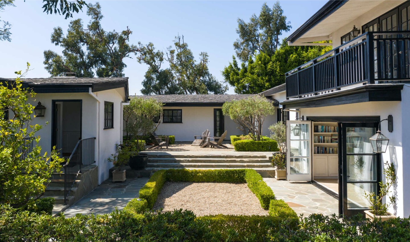 The gated compound includes a traditional-style home built in the 1950s, a guesthouse, swimming pool, spa, courtyard and vegetable gardens.