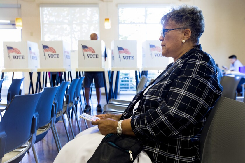 Jacqueline Purdy of Inglewood waits for her turn to vote early at the East Los Angeles Library on Oct. 27.