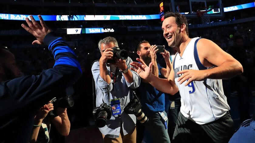 Tony Romo is introduced with the Dallas Mavericks starters before a game against Denver on April 11.