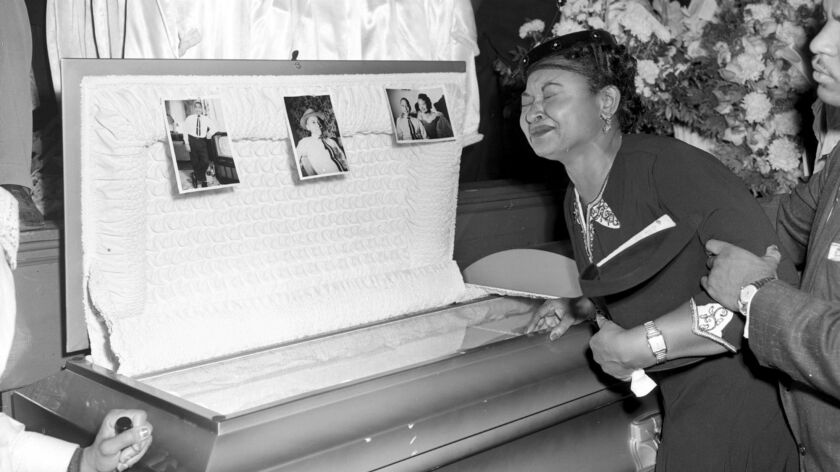Mamie Till at the funeral of her son Emmett Till. Her insistence on an open casket allowed people to see how brutally the 14-year-old had been killed.