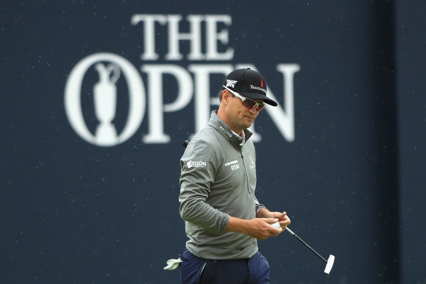 Zach Johnson of the United States celebrates a birdie on the 18th hole Friday in the second round of the British Open.