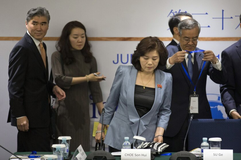 Choe Son Hui, third from left, deputy director general of the Department of US Affairs of North Korea Foreign Ministry, prepares to sit as Sung Kim, special representative for North Korean Policy of the U.S. Department of State, left, arrives to attend the 26th Northeast Asia Cooperation Dialogue i