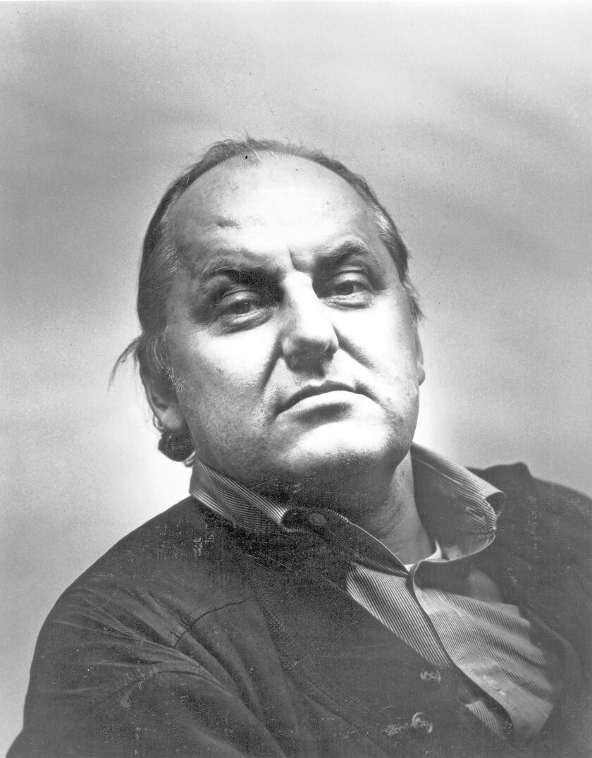Austrian architect Hans Hollein, shown around the time he received the 1985 Pritzker Prize for architecture, has died in Vienna at 80.