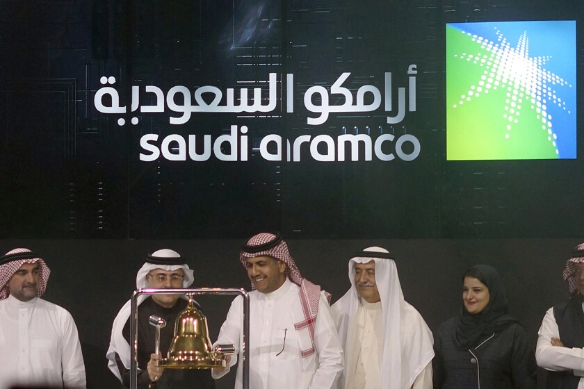 Officials celebrate the stock market debut of Saudi Aramco, Saudi Arabia's state-owned oil company, in Riyadh in December.
