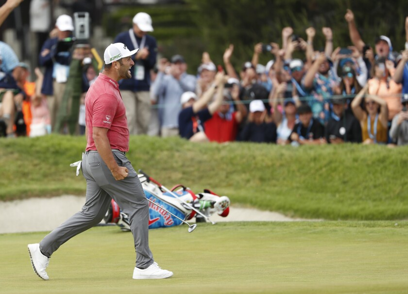 Jon Rahm celebrates birdie putt on the 18th green to win the U.S. Open in June at Torrey Pines Golf Course.