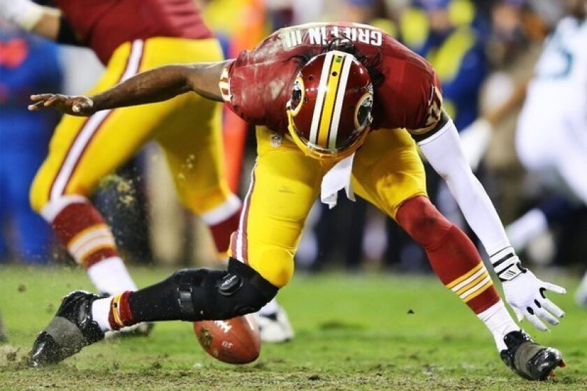 RG3 knee injury: Coach Mike Shanahan should not have let him play