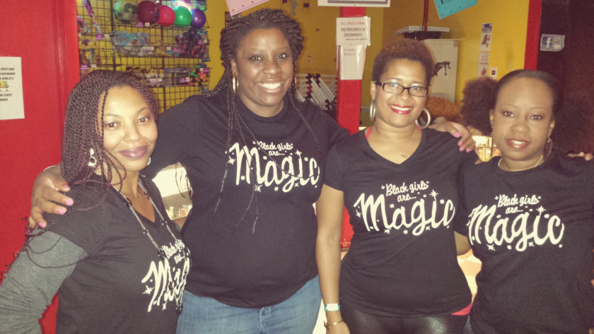 """CaShawn Thompson, right, and friends pose with the """"Black Girls are Magic"""" shirts she designed."""