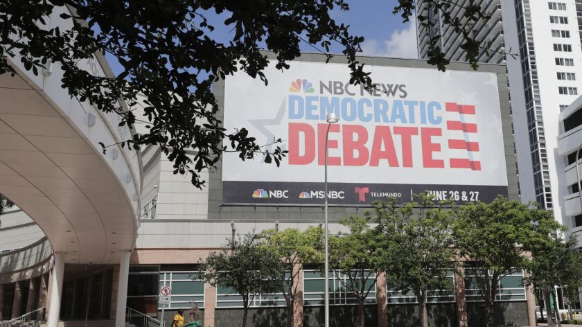 A billboard advertises the Democratic Presidential Debates across from the Knight Concert Hall at th