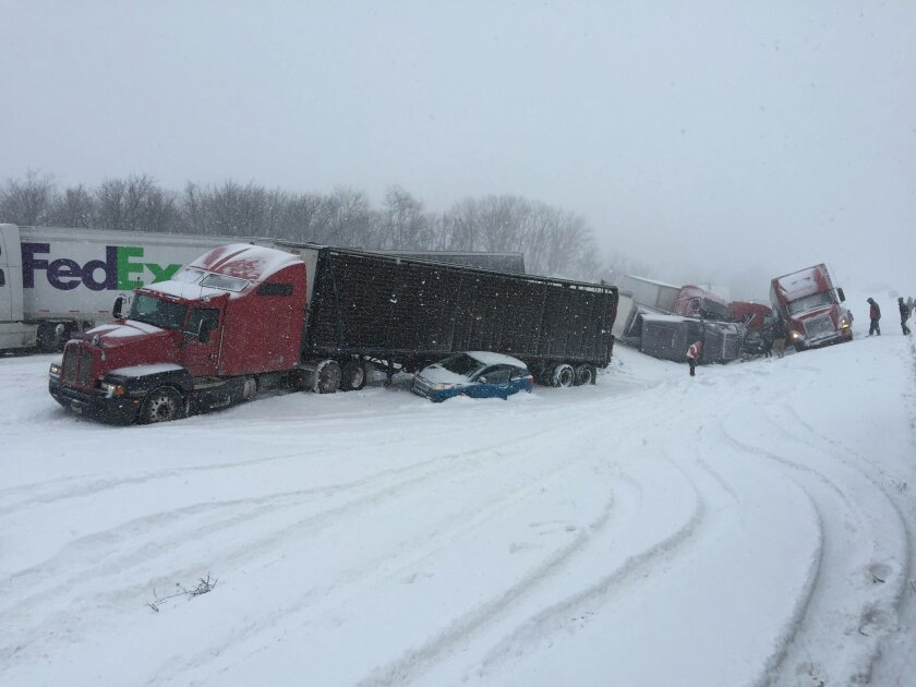Vehicles pile up at the site of a fatal crash near Fredericksburg, Pa., Saturday, Feb. 13, 2016. The pileup left tractor-trailers, box trucks and cars tangled together across several lanes of traffic and into the snow-covered median. (Cooper Leslie via AP)